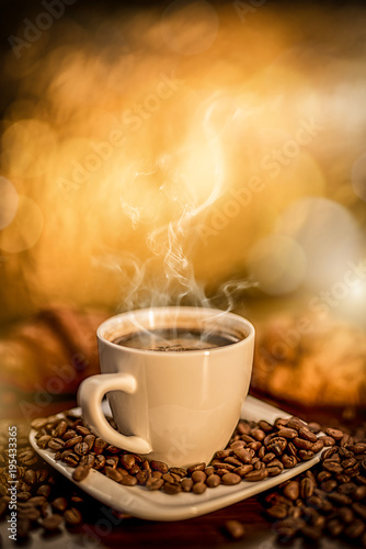 Fototapety, obrazy: fresh hot coffee laid on the table, roasted coffee beans fried like a decoration on a wooden table, blurred background