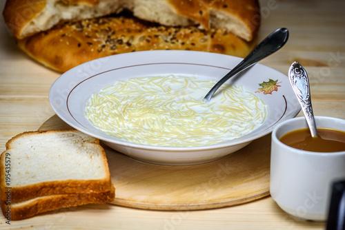 Deurstickers Klaar gerecht a plate of milk soup with vermicelli