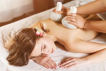 Obraz na płótnie Canvas Beautiful young woman having back massage close up