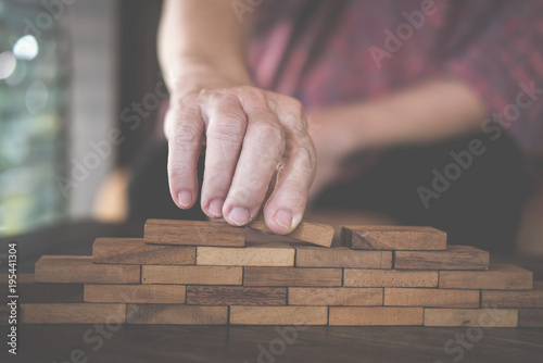 Fototapety, obrazy: hand stacking wood block. growth, success & development in business
