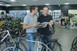 happy smiling man choosing new sport bike