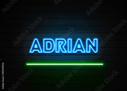 Photo  Adrian neon sign mounted on brick wall.