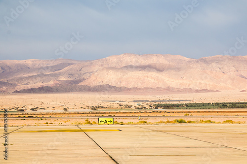 Papiers peints Beige Mountains and sky with clouds in Jordan in a day