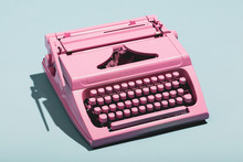 Pink Typewriter On A Blue Past...