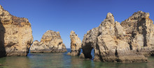 Rocky Coast At Ponta Da Piedad...