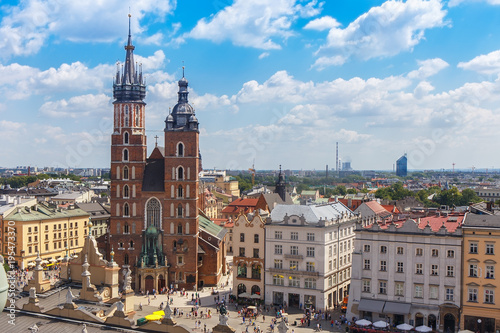.View of the mariacki church and the roof of the building sukiennice from the height of the town hall building in the Polish city of Krakow.