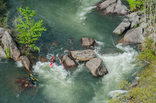 Two Kayaks In Rapids