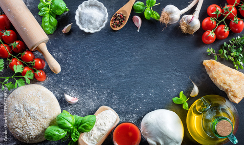Pizza Preparation With Ingredients On Black Table - Italian Food