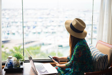Woman Is Working While Travel Vacation.
