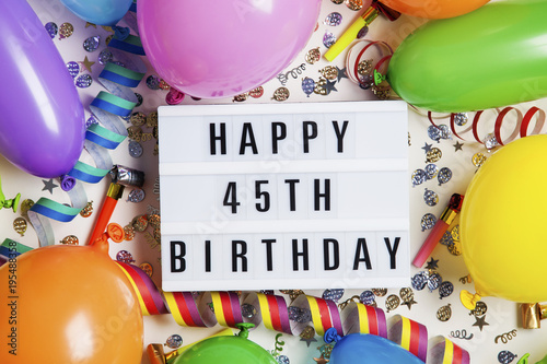 Happy 45th Birthday Celebration Message On A Lightbox With Balloons And Confetti