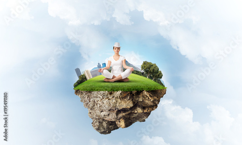 Young woman keeping mind conscious.