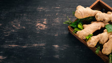 Fresh Ginger On A Wooden Backg...