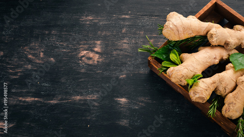Fotografie, Obraz Fresh ginger on a wooden background. Top view. Copy space.