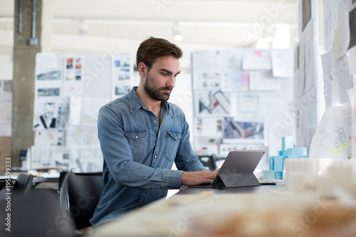 Man using digital tablet in the office