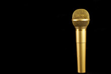 Golden Microphone On Black Bac...