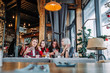 canvas print picture - Four beautiful young woman doing selfie in a cafe, best friends girls together having fun
