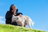 Fototapeta Zwierzęta - Perros y animales de compañia.Chica jugando con sus mascotas en el parque.Educacion y entrenamiento de perros