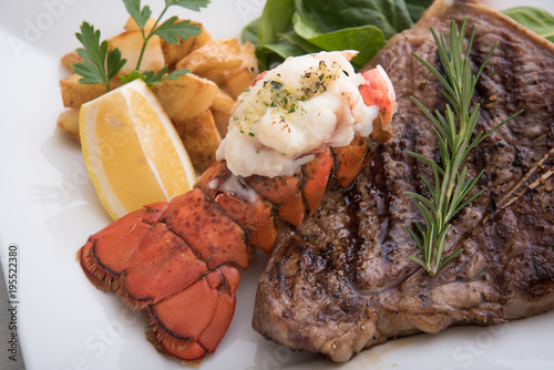 grilled lobster tail and T bone steak