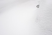 Car Mirror And Car Covered With Snow After Heavy Snowfall