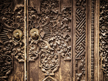Carved Wooden Door With Floral And Geometric Designs. Ubud, Bali, Indonesia. December 2015