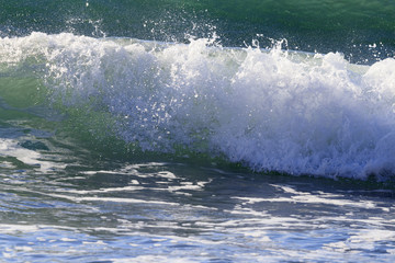 Breaking waves on Mediterranean sea shore, in south of France