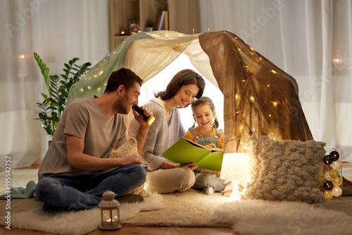Fotografie, Obraz  happy family reading book in kids tent at home