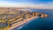 Aerial View Of The California Coast And Ocean In Dana Point, Orange County On A Sunny Day With The Harbor In View.
