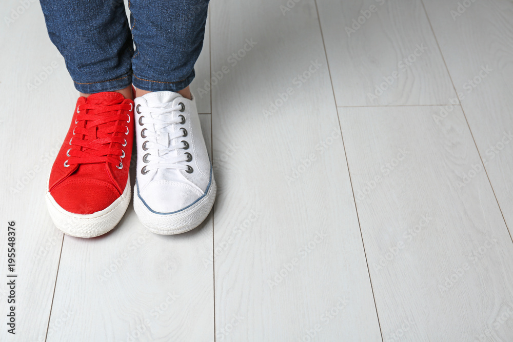 Fototapety, obrazy: Woman in different sneakers indoors