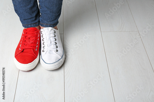 Fotografía  Woman in different sneakers indoors