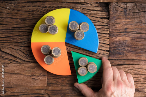 Fotomural Businessperson Taking Piece With Money From Pie Chart
