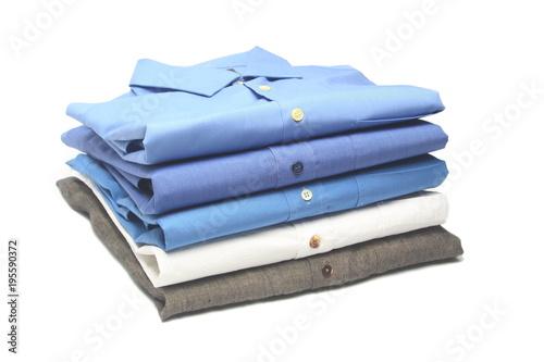 Fotografía  camisa planchada y doblada en la tintoreria