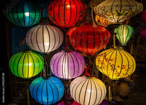 Photo  many colors of silk lanterns lit up at night