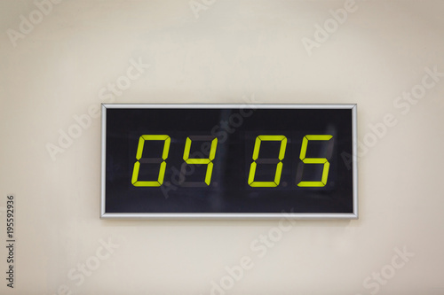 Photo  Black digital clock on a white background showing Star Wars