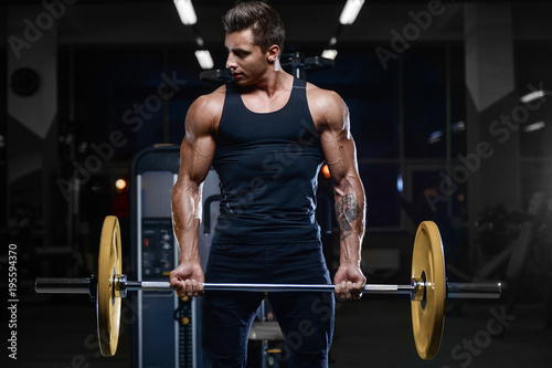 Foto op Plexiglas Fitness Handsome model young man workout in gym