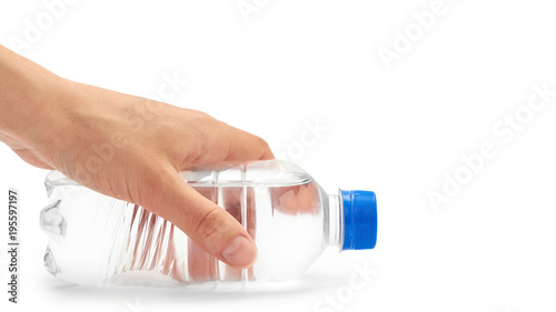 female hand holds clean and fresh water packed in a plastic bottle