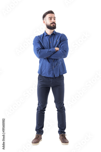 Fototapeta Confident cool young bearded man standing and looking away with crossed hands. Full body isolated on white background.  obraz