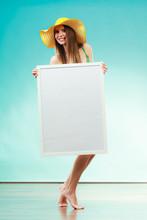 Woman In Bikini Holds Blank Presentation Board.