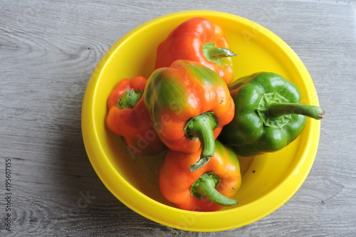 Fotografie, Obraz  Orange, red and green peppers in a bowl