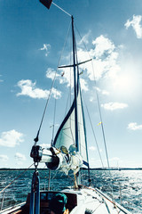 Fototapeta Morze Yachting on sail boat during sunny weather