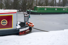 Boats Stuck In Frozen Canal Af...