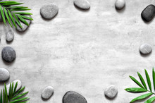 Grey Spa Background, Palm Leaves And Grey Stones, Top View