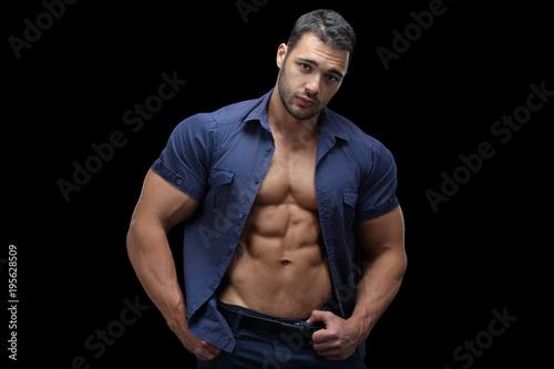 Fotografie, Obraz  Macho male standing in front of black background
