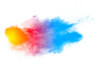 Multicolored powder explosion isolated on white background. Colored dust splash cloud on white background. Launched colorful particles on background.