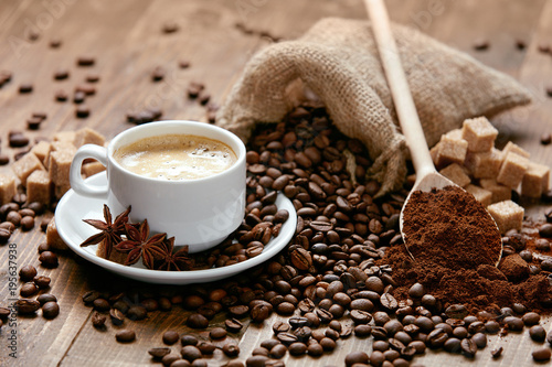 Spoed Foto op Canvas Cafe Cup Of Coffee And Coffee Beans On Table.