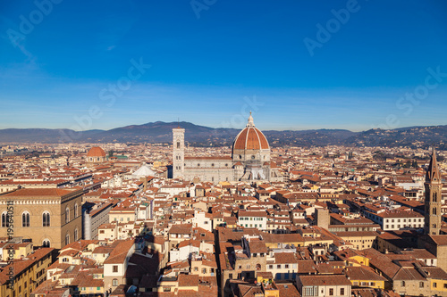 Photo Stands Florence Cathedral of Santa Maria del Fiore, view from the Piazza della Signoria over the rooftops, Florence, Tuscany, Italy