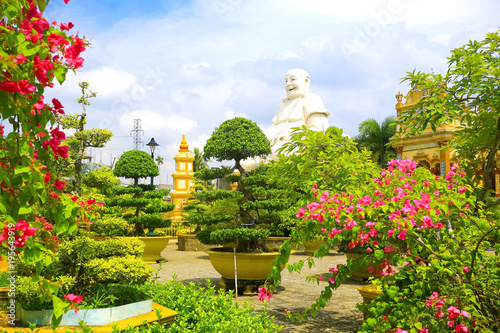 Keuken foto achterwand Temple Tropical garden with flowers and trees