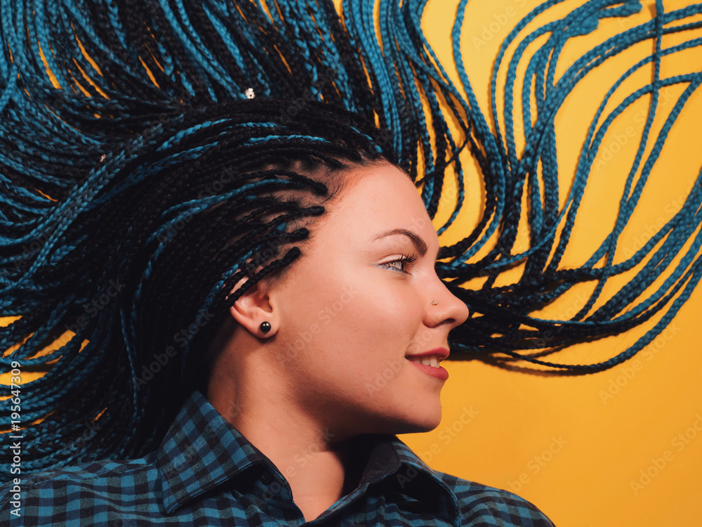 Fototapety, obrazy: Beautiful young girl with african blue braids. Woman on bright yellow background. Dyed Hair moves. Hipster.