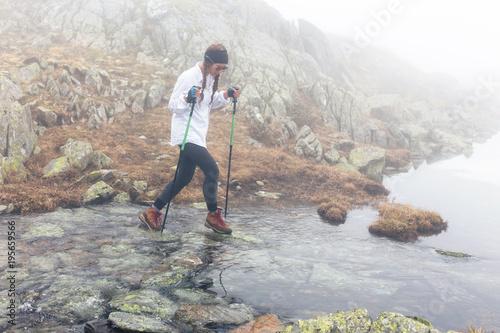 Fototapeta Girl is traveling on a river. obraz na płótnie