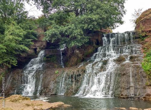 Foto op Aluminium Grijze traf. Waterfall in the autumn . Dzhurinsky Falls - the largest plain waterfall in Europe