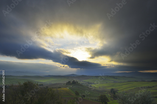 Countryside with Farmhouse and Stormy Sky, San Quirico d'Orcia, Val d'Orcia, Province of Siena, Tuscany, Italy
